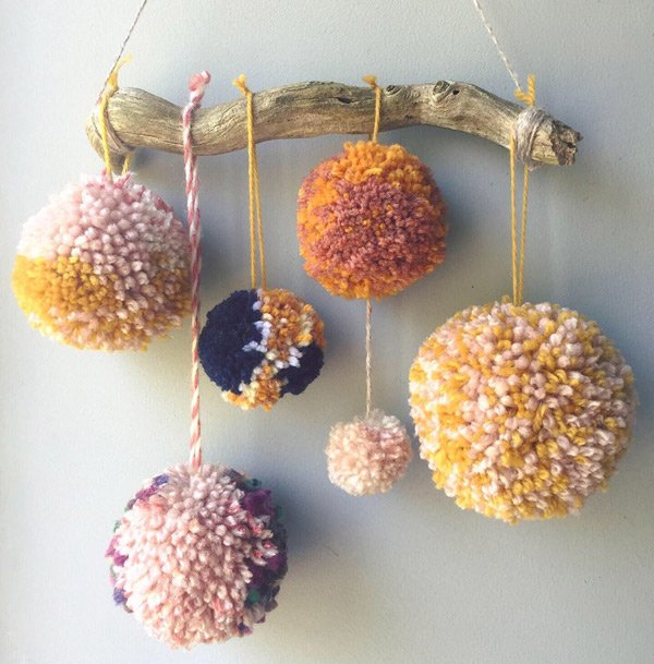 Wall-hanging-with-Cornish-driftwood-and-pom-poms